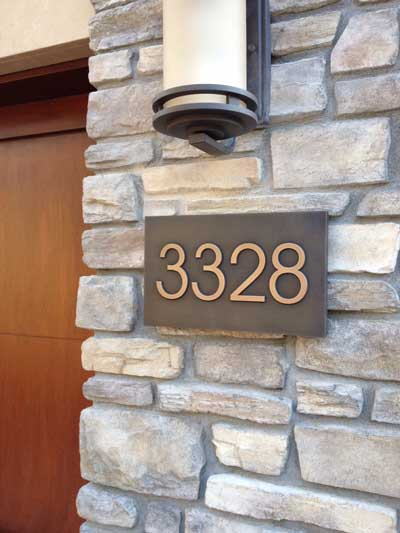 Check out this classy number plaque by Atlas Signs and Plaques.