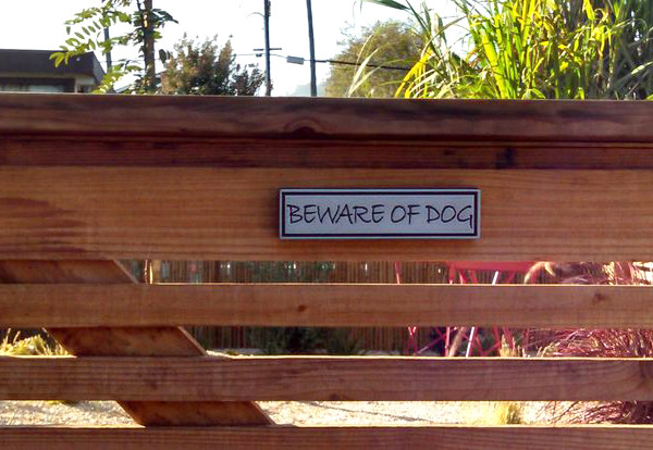 Attached are a couple of photos of our new sign and below are links to the photos pinned to my Pinterest board. We recently landscaped our front yard and it was impossible to find a Beware of Dog sign that would look nice on our gate. I was so happy to come across your site and find exactly what we were looking for. Every time I see our sign I smile. :) -Su 9/2014