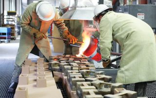 Bronze being poured into a mold